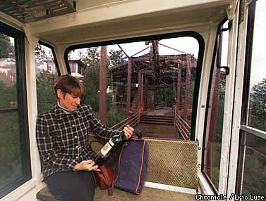 Jennifer Masse,Placerville, drove to her fathers home in Novato to pick up his 1961 Chateau Lafit -Rothschild. Here she rides up the tram at Sterling Vineyards to have the bottle recorked and topped up by personnel from Chateau Lafite.  Photo by Eric Luse Photo: Eric Luse