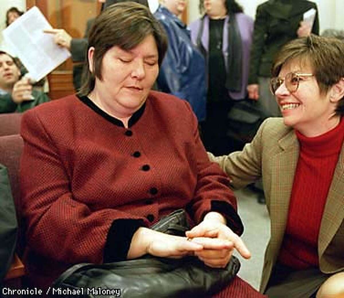 Attorney Laurie Saunders (right) tries to cheer up a pensive Marlene Corrigan just prior to Corrigan's sentencing in Contra Costa County Superior Court in Martinez. Corrigan was sentanced to community service for misdemeanor child abuse of her obese daughter who died last year. Saunders is one of her attorneys along with Michael Cardoza. Photo by Michael Maloney