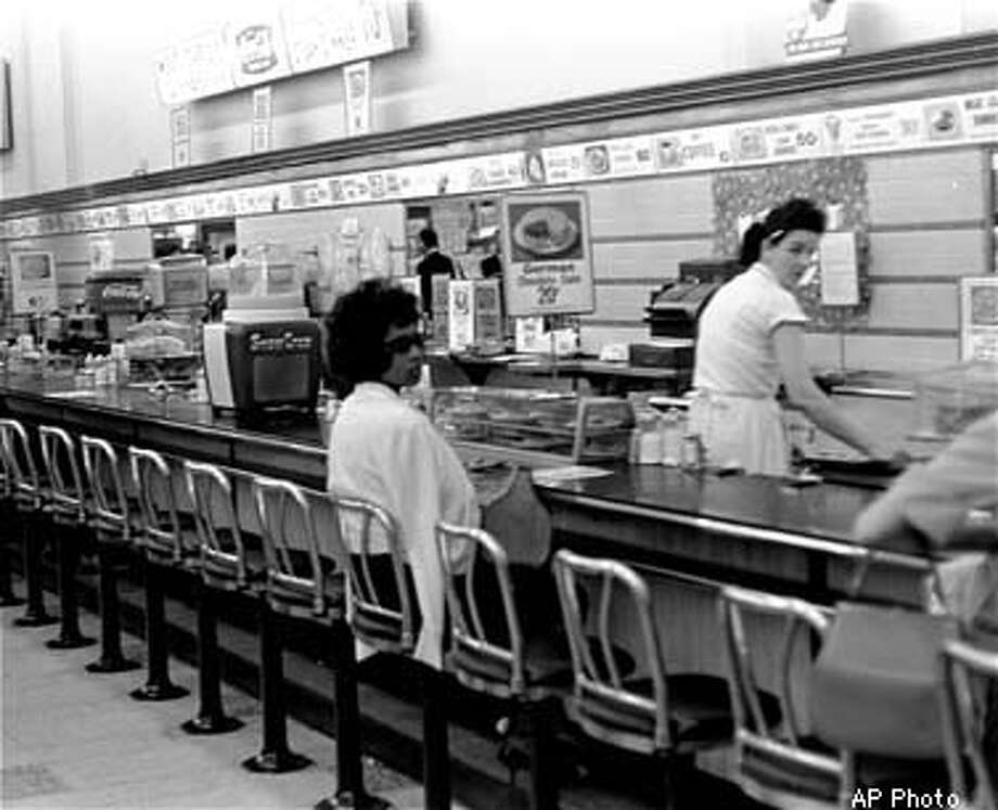 Black college student Dorothy Bell, 19, of Birmingham, Ala., waits in a downtown Birmingham lunch counter for service that never came. She was arrested with 20 others in sit-in attempts. (AP Photo) Photo: PFO