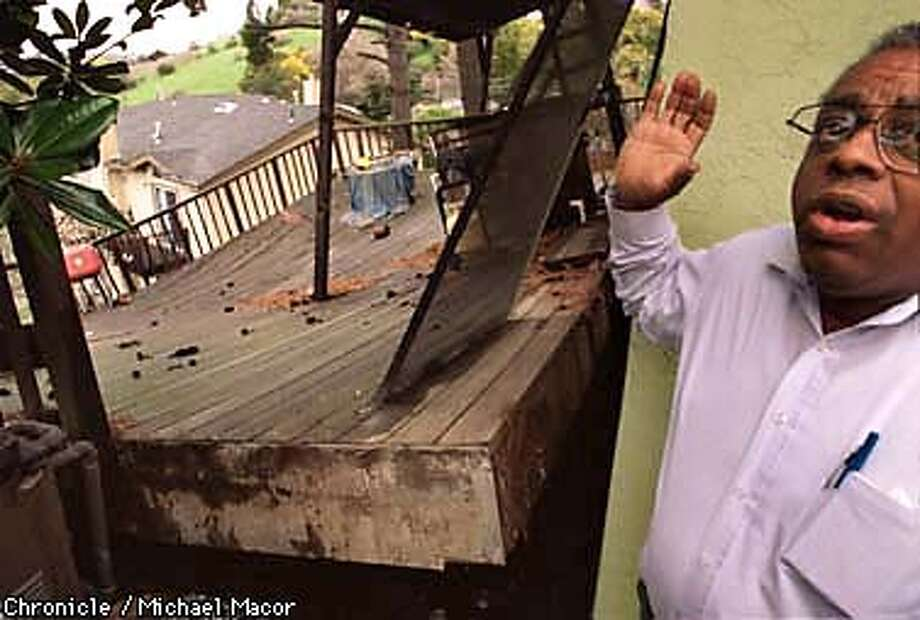 Oakland homeowner Clyde Lewis shows his backyard wood deck that has slide off the rear of his home. The house at 7331 Hillmont Dr. in Oakland lost the deck when a retaining wall that supports the earth behind his property gave way and took the patio in the land slide. Chronicle Photo: Michael Macor Photo: MICHAEL MACOR