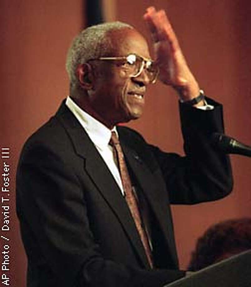 Historian John Hope Franklin speaks at the Governors Conference on Racial Reconciliation in Charlotte, N.C. Tuesday Oct. 28, 1997. Franklin became storyteller Tuesday at a conference on racial reconciliation, sharing several anecdotes from his own life to depict what it's like to be a black man in America. (AP Photo/The Charlotte Observer, David T. Foster III) Photo: DAVID T. FOSTER III