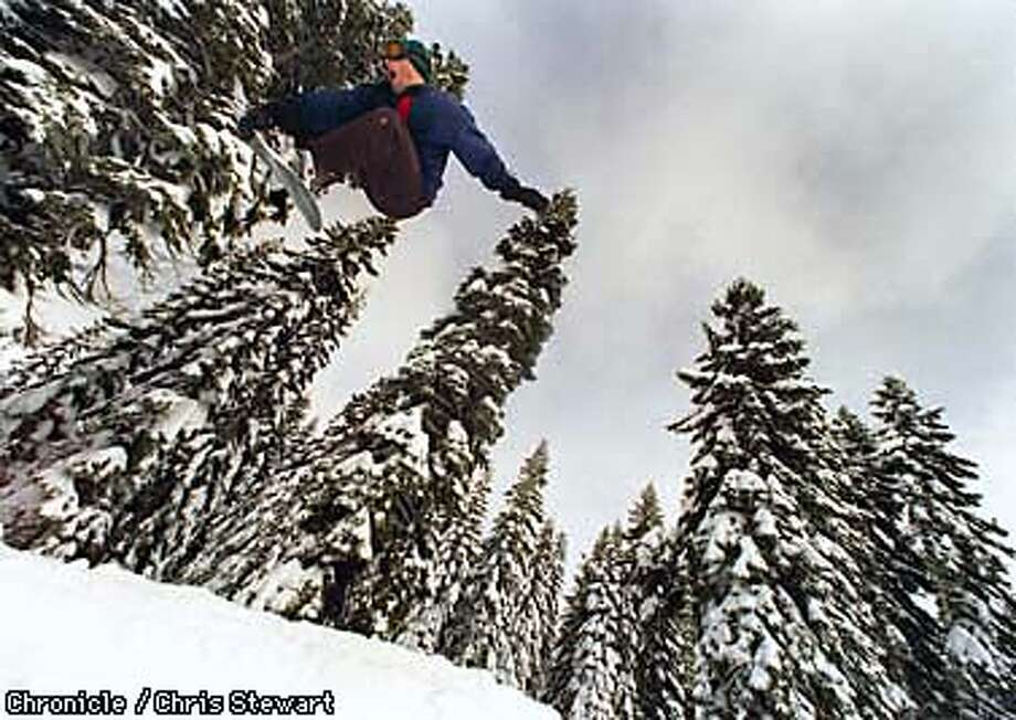 A snowboarder gets extreme air off a jump at the Jibassic terrain park at Boreal Ski Area near Truckee, California. SAN FRANCISCO CHRONICLE PHOTO BY CHRIS STEWART Photo: CHRIS STEWART
