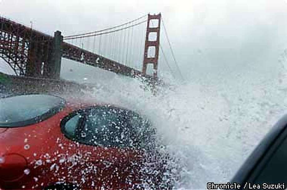 Although there was a big break in the rain during the day on Sunday, surfers, bicyclists, cars and visitors to Fort Point on Sunday got drenched by the huge waves breaking over the barrier and onto the cars. Photo By Lea Suzuki Photo: LEA SUZUKI