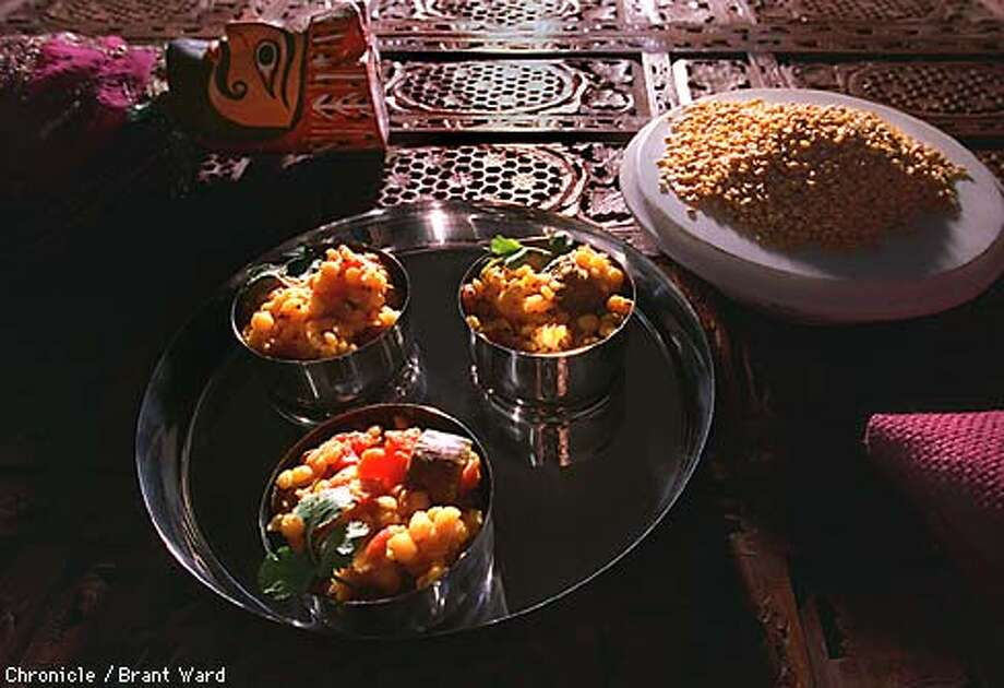 SAMBARS1/29JAN98/FD/WARD--Sambars, in India, are often served in small bowls with rice and other soups. Photographed at the Bazaar of India in Berkeley. By Brant Ward/Chronicle