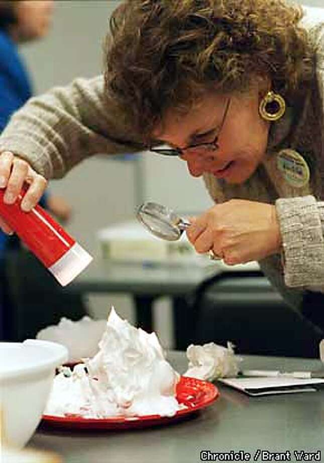 Jackie Munoz, a principal in the Aromas-San Juan school district in San Benito county, got good and close to some shaving cream she was examining for texture. She was part of the gathering of school officials at the Exploratorium exploring science. By Brant Ward/Chronicle