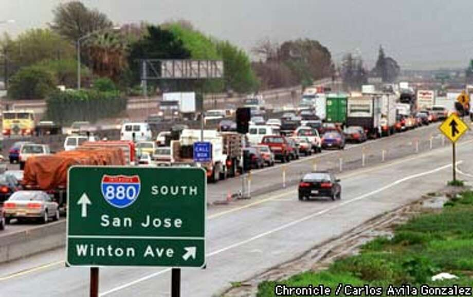 Caught somewhere between brake lights and bad moods, some Southbound I-880 drivers near Hayward are left wondering if BART will ever take them to San Jose, and whether a new BART station in Warm Springs is even worth the trouble. (CHRONICLE PHOTO BY CARLOS AVILA GONZALEZ) Photo: CARLOS AVILA GONZALEZ