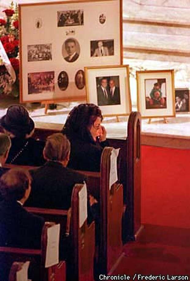 ALIOTO ANGELA/C/MN/FRL: Surrounded by family photograph during Joseph Alioto funeral, Joe daughter, Angela drys a tear from her face. Chronicle photo by Frederic Larson.