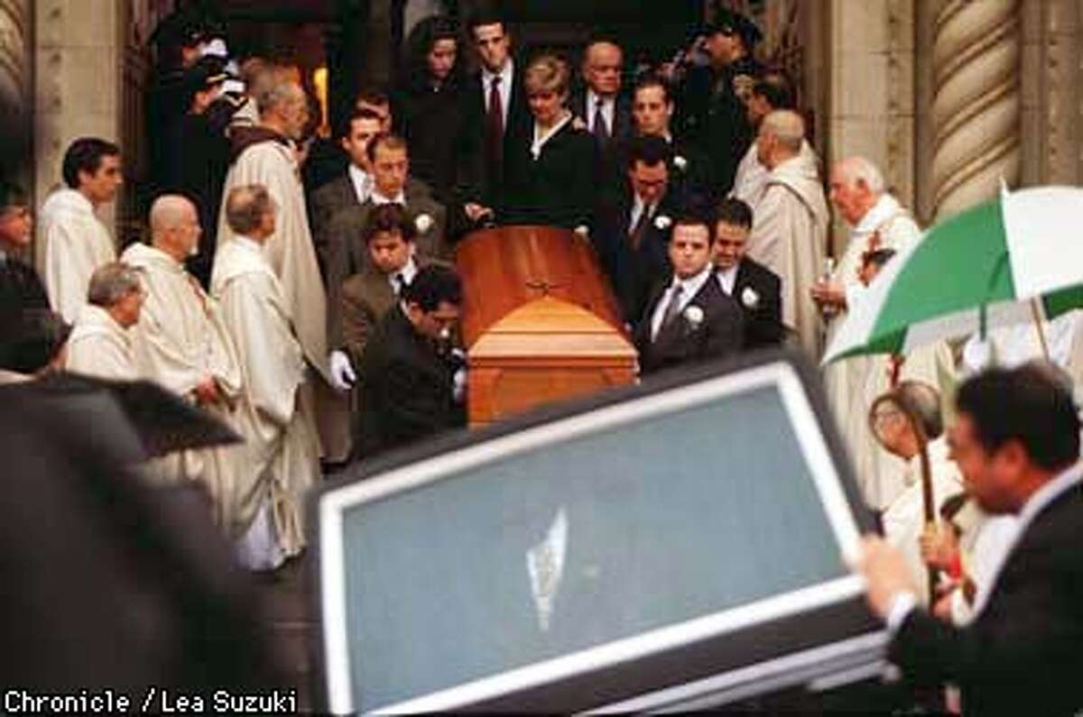 Joseph Alioto's casket is removed from St. Peter and Paul's Cathedral following the funeral service on Monday morning. Photo By Lea Suzuki