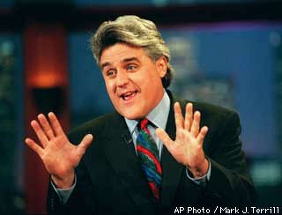 "Jay Leno performs his monolog Sept. 30, 1996, on ""The Tonight Show with Jay Leno"" in Burbank, Calif. Leno has written a new book, ""Leading with My Chin,"" which he says is not an autobiography. (AP Photo/Mark J. Terrill) Photo: MARK J. TERRILL"
