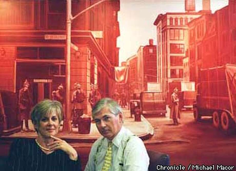 """Bay Area art collectors Vicki and Kent Logan who have made large donations to the San Francisco Museum of Modern Art. They are in front of a Mark Tansey painting titled """" Occupation"""" , 1984. Chronicle Photo: Michael Macor Photo: MICHAEL MACOR"""