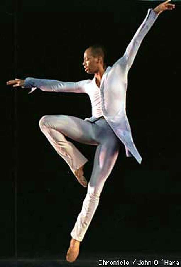 """Dance Theatre of Harlem"".  Adrian (Angel on Earth) Cedric Rouse in performance.  Photo by............John O'Hara"