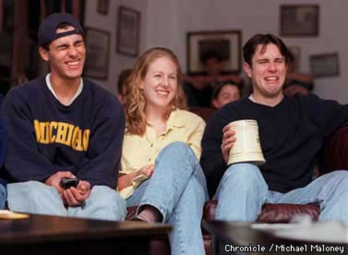 Every Wednesday night, UCB students gather at the Delta Epsilon Fraternity House to watch the politically incorrect cartoon show, South Park. Pictured from left is Mark Kamal, Lindsey Davis and Scott Fausel. Photo by Michael Maloney
