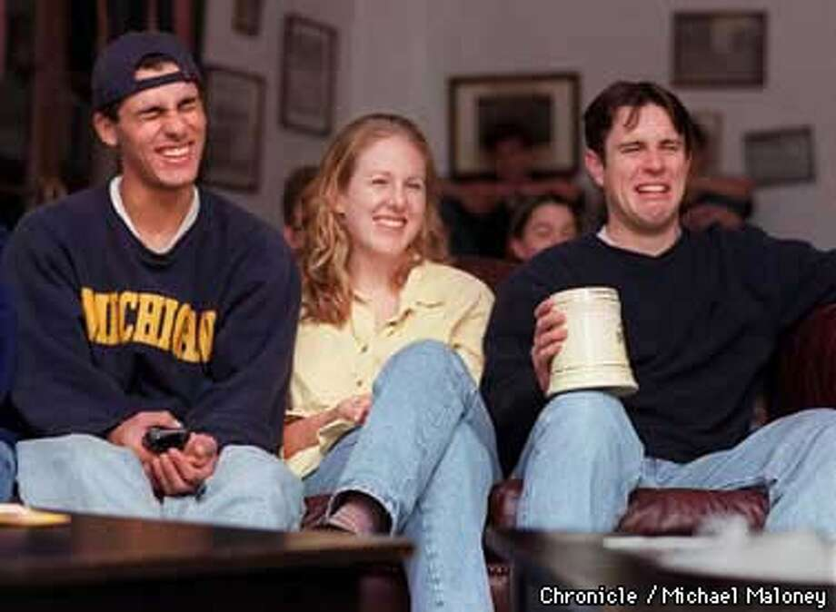 Every Wednesday night, UCB students gather at the Delta Epsilon Fraternity House to watch the politically incorrect cartoon show, South Park.  Pictured from left is Mark Kamal, Lindsey Davis and Scott Fausel.  Photo by Michael Maloney Photo: MICHAEL MALONEY