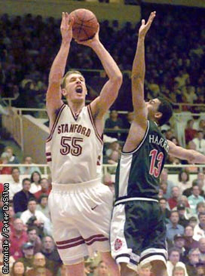 STANFORD 1/C/29JAN98/SP/PDS----Stanford's Tim Young goes up over Arizona's Wildcats Donnell Harris in the first half of their game at Maples Pavilion. Photo By:Peter DaSilva Photo: Peter DaSilva