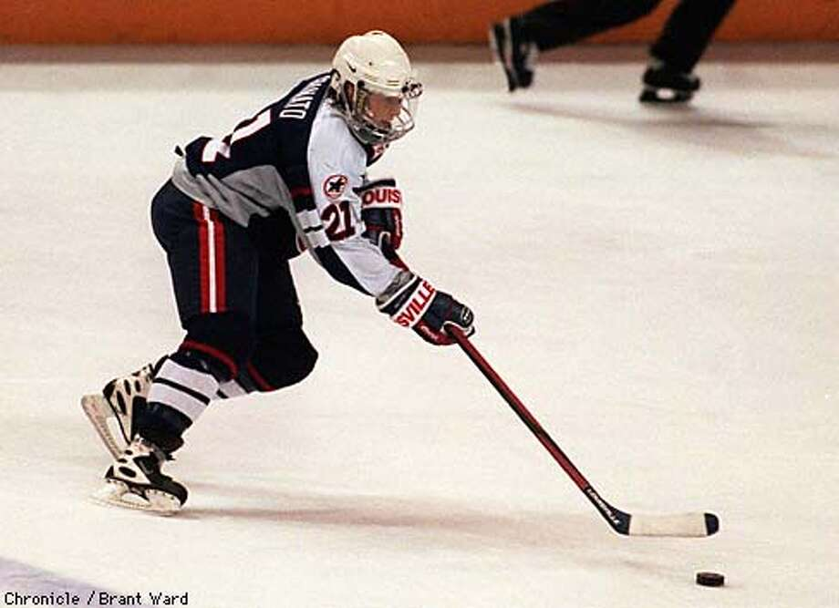 USA Women's hockey team member Cammi Granato in action against Canada. By Brant Ward/Chronicle