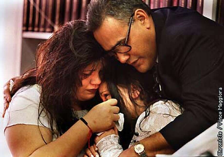 = L TO R Tina Garcia , Sapphire Garcia daughters of Mark Garcia who dided in SF police custody and Dan Garcia Marks brother at a PC about Marks death. by Vince Maggiora Photo: VINCE MAGGIORA