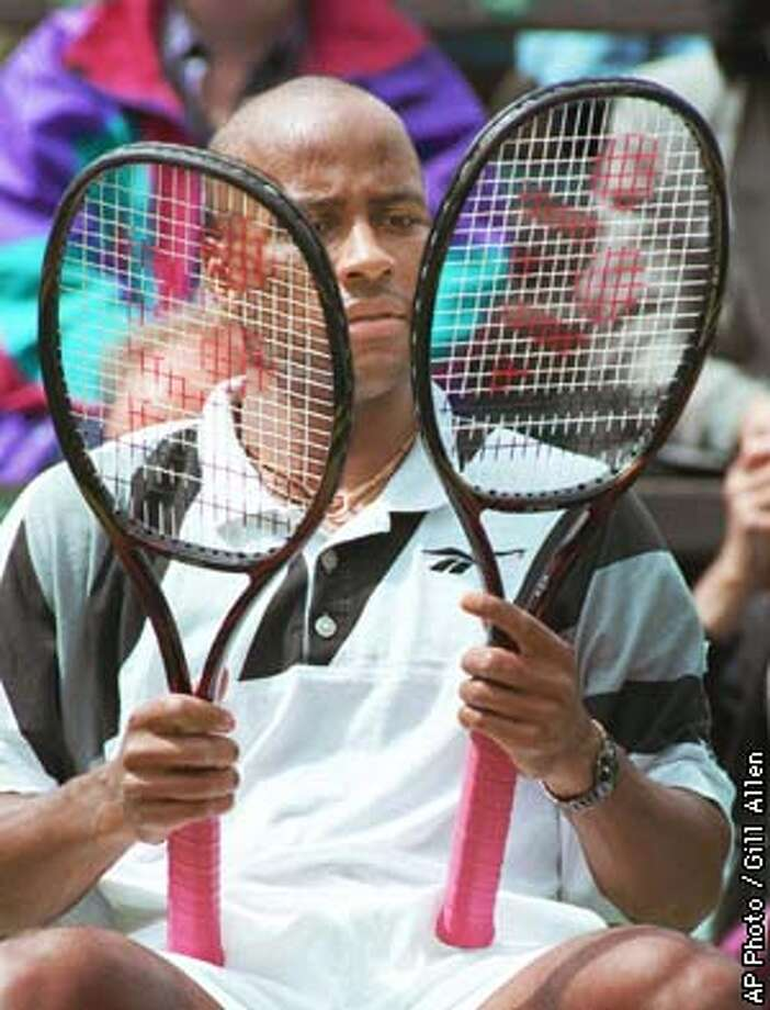 Malivai Washington of Ponte Vedra Beach, Fla., makes his choice of racquet, during his Men's Singles quarter-final against Germany's Alexander Radulescu on 's Number One Court Thursday July 4, 1996. (AP Photo/Gill Allen) Photo: GILL ALLEN