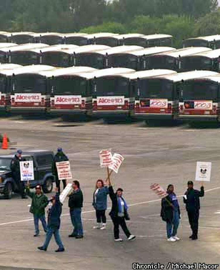 "Contra Costa's transit system ""County Connection"" is currently under a strike from it's drivers. Driver pickett the bus yard in Concord as the fleet of buses sit idle in the background. Chronicle Photo: Michael Macor Photo: MICHAEL MACOR"