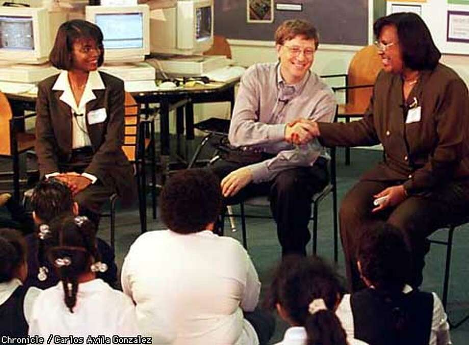 Microsoft chief Bill Gates, shakes hands with Cesar Chavez Academy Principal Ruth Woods, in Michelle Williams's third grade classroom where Gates visited to see technology in education. (CHRONICLE PHOTO BY CARLOS AVILA GONZALEZ) Photo: CARLOS AVILA GONZALEZ