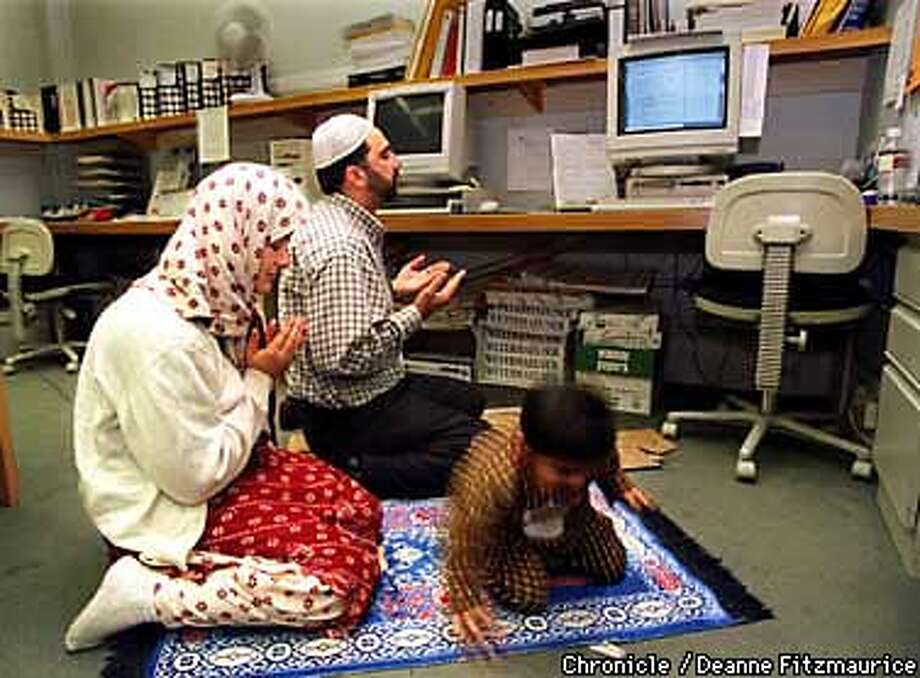 Bay Area Muslims combine the observance of Ramadan with their jobs and work schedules. Inam Choudhary takes a break from his job at Speedway Copy Systems to pray with his wife, Tanzeela and their son Basit, 2, in the middle of the Speedway office. She came to deliver food and to pray with him. CHRONICLE PHOTO BY DEANNE FITZMAURICE Photo: DEANNE FITZMAURICE