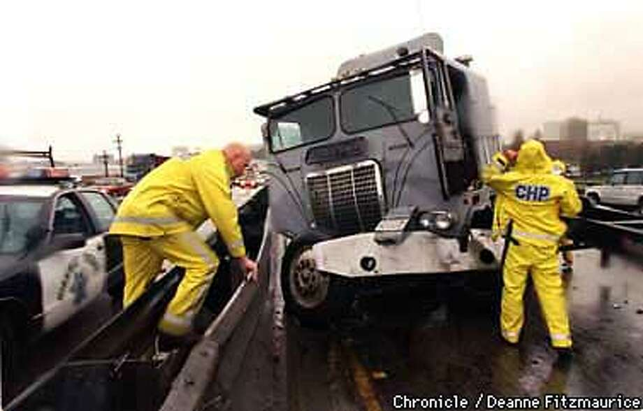 California Highway Patrol officers arrive on scene at a bigrig accident northbound on I880 in Oakland. Driver Manuel Escovar lost control of the rig as he tried to slow when traffic stopped for another Bigrig accident half a mile further north on I880. Escovar was unhurt and there were no other cars involved. CHRONICLE PHOTO BY DEANNE FITZMAURICE Photo: DEANNE FITZMAURICE