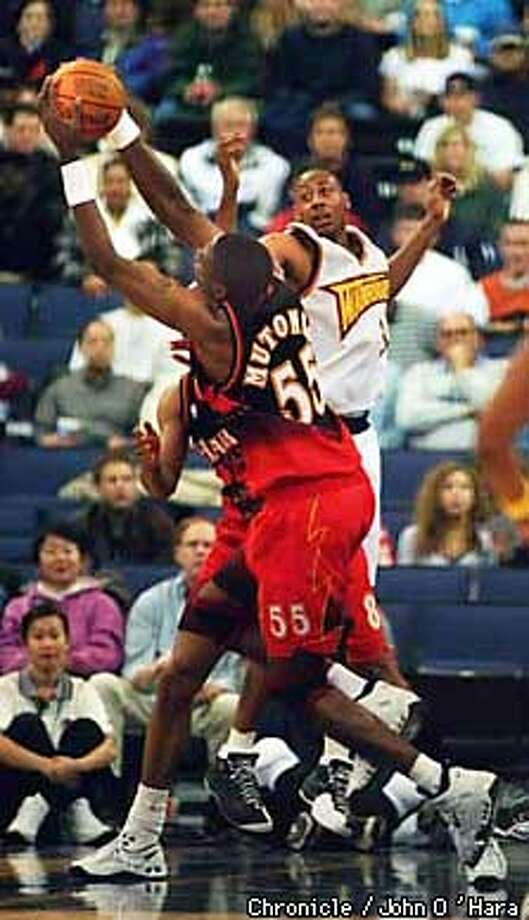 Warrios V/S Hawks.  Hawks #55 Dikembe Mutombo collects a defensive rebound out of the reach of Donyell Marshall.  Photo by.........John O'Hara