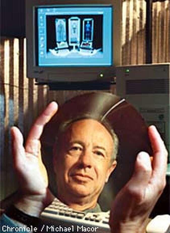INTEL's CEO Andy Grove is reflected in a silicon wafer, used in the manufacturing of computer chips. Chronicle Photo: Michael Macor Photo: MICHAEL MACOR