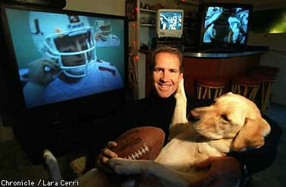 Russ Hafferkamp and his faithful hound Syd are geared up to watch New Year's Day football games in the comfort of their own hi-tech home entertainment center. (CHRONICLE PHOTO BY LARA CERRI) Photo: LARA CERRI
