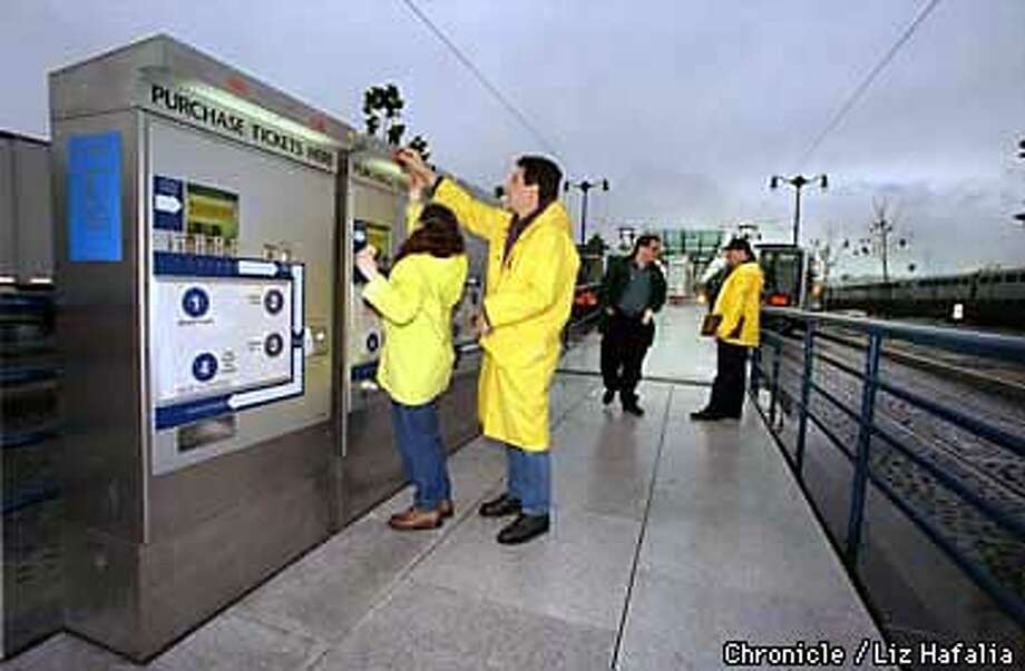 Muni painters place Muni logo on P.O.P.--Proof of Payment-- machines at Fourth on King streets. Instead of paying at the farebox when you get on the E line, you would buy a ticket from this fare machine at the entrance to the station, and bord at any door, as in the subway. SF Police officers perform random inspections to insure all passengers have proof of payment. If you don't you will be cited with a fine of $126 dollars. Liz Hafalia Photo: Liz Hafalia