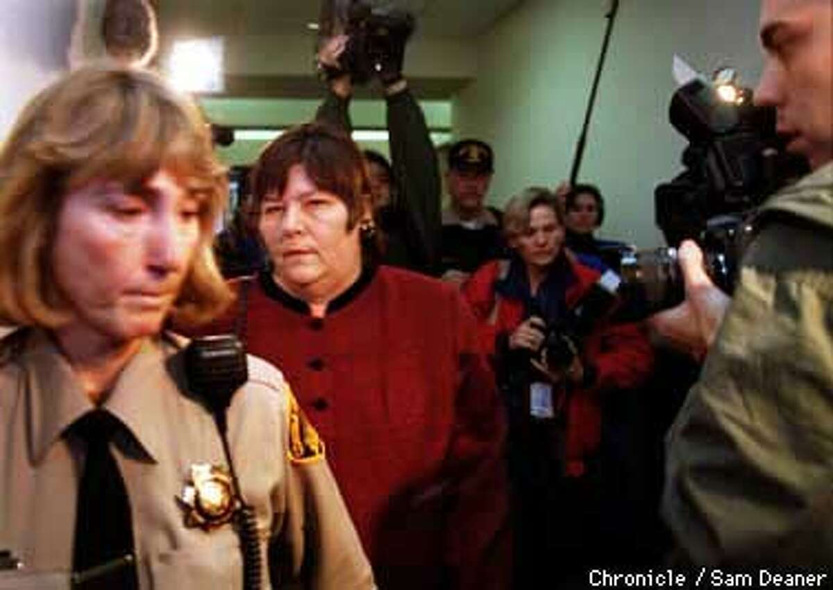 Marlene Corrigan, 2nd from left, is led from the courtroom chased my media persons after a ruling was handed down convicting Corrigan of misdemeanor child abuse Friday in Martinez. (Chronicle Photo by Sam Deaner)