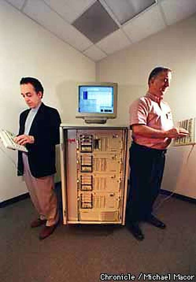 """""""ZITEL"""" of Fremont. Arthur Chait, left VP and GM Solutions Services Division and Michael Fidel, Technology Manager, with the company's Portable Code Conversion Factory that will solve the problem of the year 2000 encoding in todays computer systems. The first of it's kind ever. Chronicle Photo: Michael Macor Photo: MICHAEL MACOR"""