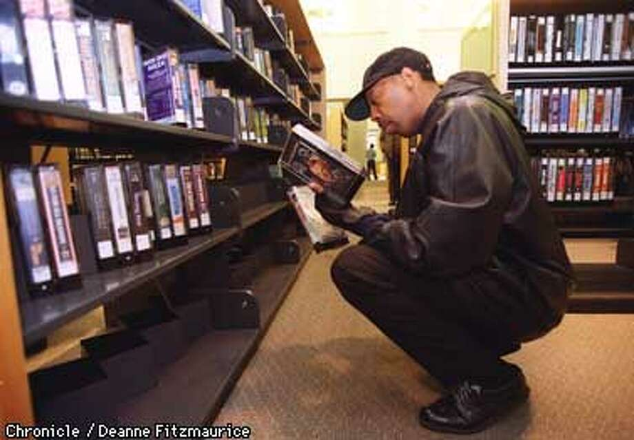 Gary Mason chooses a video to check out from the S.F. Public Library. He thinks that the library has a broader selection than most video stores and likes the non-commercial aspect that the library does not push certain movies with posters, etc. as they do in video stores. CHRONICLE PHOTO BY DEANNE FITZMAURICE Photo: DEANNE FITZMAURICE