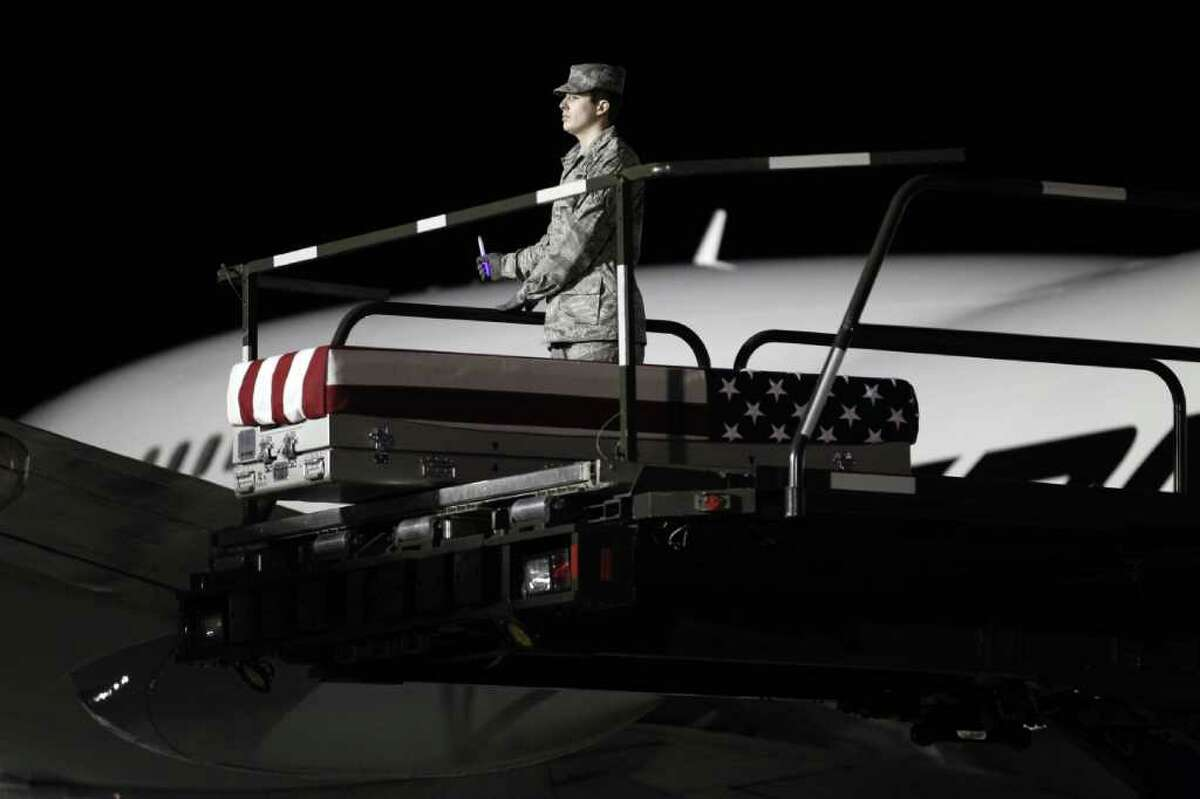 The transfer case containing the remains of Marine Sgt. William C. Stacey of Redding, Calif., sits at the end of the loader ramp upon arrival at Dover Air Force Base, Del. on Thursday, Feb. 2, 2012. The Department of Defense announced the death of Stacey who was supporting Operation Enduring Freedom in Afghanistan.