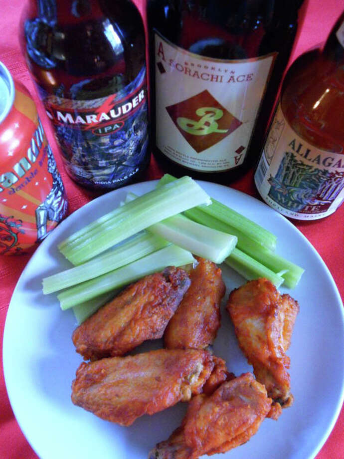 Wings and beer -- a winning combination for Super Bowl party menus. Photo: Patti Woods / Fairfield Citizen contributed