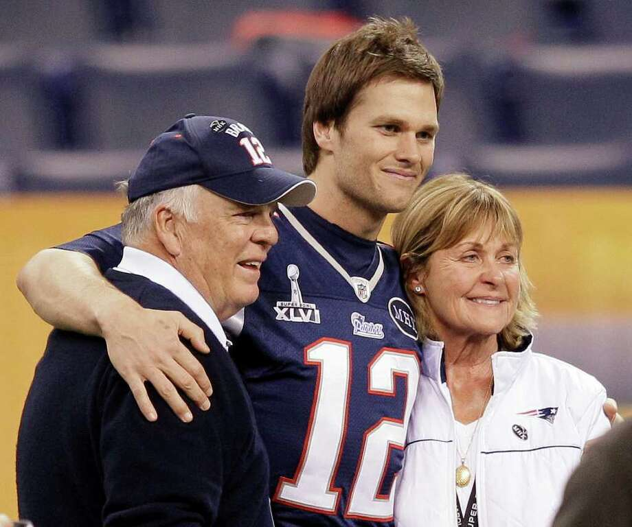 New England Patriots quarterback Tom Brady (12) poses for a photo with his parents, Tom and Galynn Brady, in Lucas Oil Stadium on Saturday, Feb. 4, 2012, in Indianapolis. The Patriots are scheduled to face the New York Giants in NFL football Super Bowl XLVI on Feb. 5. (AP Photo/Mark Humphrey) Photo: Mark Humphrey
