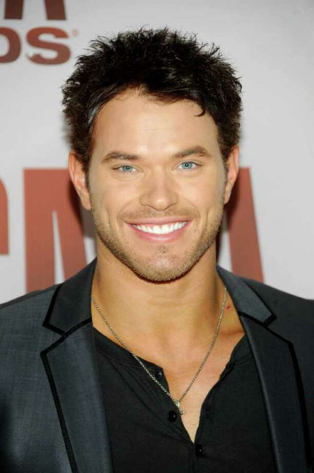 "FILE - In this Nov. 9, 2011 photo, Kellan Lutz arrives at the 45th Annual CMA Awards in Nashville, Tenn., on Wednesday, Nov. 9, 2011.   ""Twlight"" star Kellan Lutz sympathizes with Gisele Bundchen. Earlier in the week, some criticized the supermodel and wife of New England Patriots quarterback Tom Brady after a rumored email she sent to friends and family encouraging them to pray for her husband's success in the Super Bowl game against the New York Giants was leaked. (AP Photo/Evan Agostini) Photo: Evan Agostini"