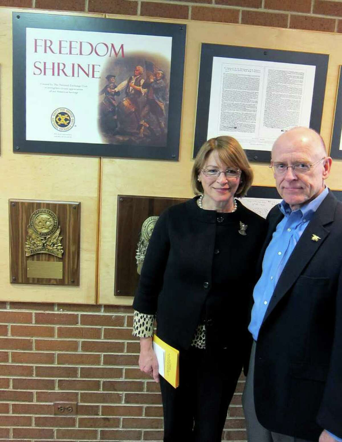 Patricia and Dr. Michael Parry stand in front of the Freedom Shrine dedicated to their son at Trinity Catholic High School on Newfield Avenue following a ceremony Saturday morning Feb. 4. Their son, Chief Petty Officer Brian Bill of the U.S. Navy SEALs, was among 30 U.S. soliders killed in a helicopter crash in Afgahnistan last summer.