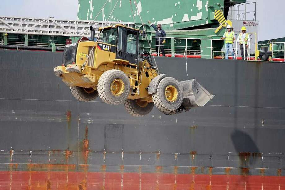 A Caterpillar wheel loader is unloaded from the Densa Eagle at the Port of Brownsville Friday, Jan. 20, 2012 in Brownsville. Photo: Edward A. Ornelas, San Antonio Express-News / © San Antonio Express-News (NFS)