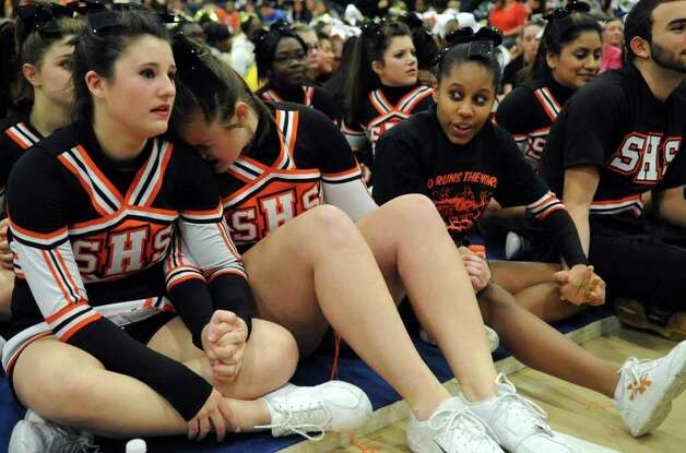Stamford High School cheerleaders wait to hear who won first place in the co-ed division during the FCIAC Cheerleading championships at Wilton High School on Saturday, February 4, 2012. Photo: Lindsay Niegelberg / Stamford Advocate