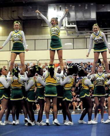 Trinity Catholic High School cheerleaders perform during the FCIAC Cheerleading championships at Wilton High School on Saturday, February 4, 2012. Photo: Lindsay Niegelberg / Stamford Advocate