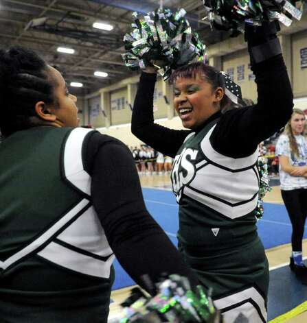 Norwalk High School cheerleaders dance during intermission at the FCIAC Cheerleading championships at Wilton High School on Saturday, February 4, 2012. Photo: Lindsay Niegelberg / Stamford Advocate