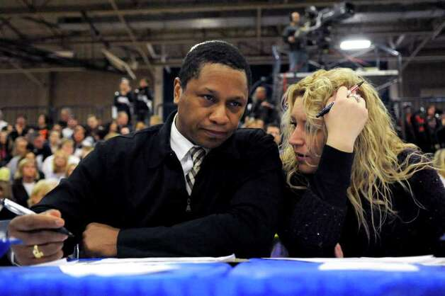 Judges confer during the FCIAC Cheerleading championships at Wilton High School on Saturday, February 4, 2012. Photo: Lindsay Niegelberg / Stamford Advocate