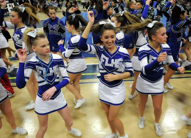 Fairfield Ludlowe cheerleaders dance during intermission at the FCIAC Cheerleading championships at Wilton High School on Saturday, February 4, 2012. Photo: Lindsay Niegelberg / Stamford Advocate