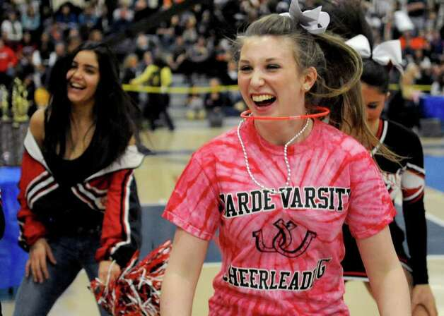 Fairfield Warde cheerleaders dance during intermission at the FCIAC Cheerleading championships at Wilton High School on Saturday, February 4, 2012. Photo: Lindsay Niegelberg / Stamford Advocate
