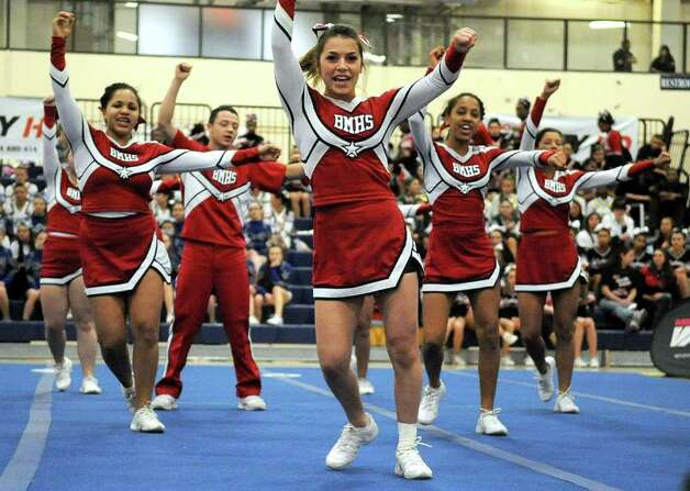 Brien McMahon High School cheerleaders perform during the FCIAC Cheerleading championships at Wilton High School on Saturday, February 4, 2012. Photo: Lindsay Niegelberg / Stamford Advocate