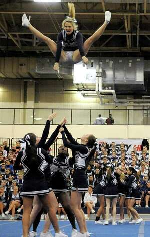 Staples High School cheerleaders perform during the FCIAC Cheerleading championships at Wilton High School on Saturday, February 4, 2012. Photo: Lindsay Niegelberg / Stamford Advocate