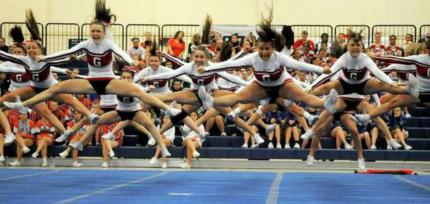 Greenwich High School cheerleaders perform during the FCIAC Cheerleading championships at Wilton High School on Saturday, February 4, 2012. Photo: Lindsay Niegelberg / Stamford Advocate