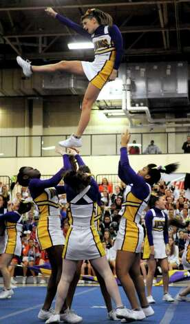 Westhill cheerleaders perform during the FCIAC Cheerleading championships at Wilton High School on Saturday, February 4, 2012. Photo: Lindsay Niegelberg / Stamford Advocate
