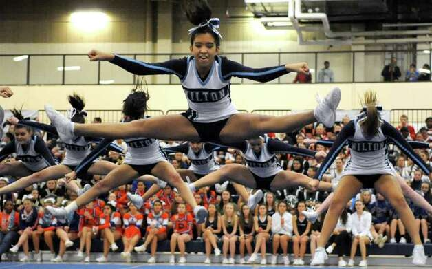 Wilton High School cheerleaders perform during the FCIAC Cheerleading championships at Wilton High School on Saturday, February 4, 2012. Photo: Lindsay Niegelberg / Stamford Advocate