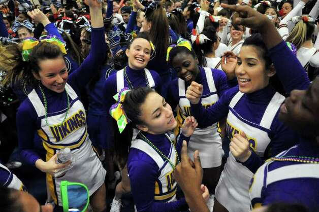 Westhill High School cheerleaders dance during an intermission at the FCIAC Cheerleading championships at Wilton High School on Saturday, February 4, 2012. Photo: Lindsay Niegelberg / Stamford Advocate